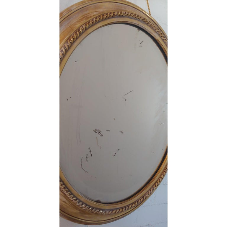 20th Century Distressed Gilt Oval Antiqued Mirror Hung by Rope For Sale