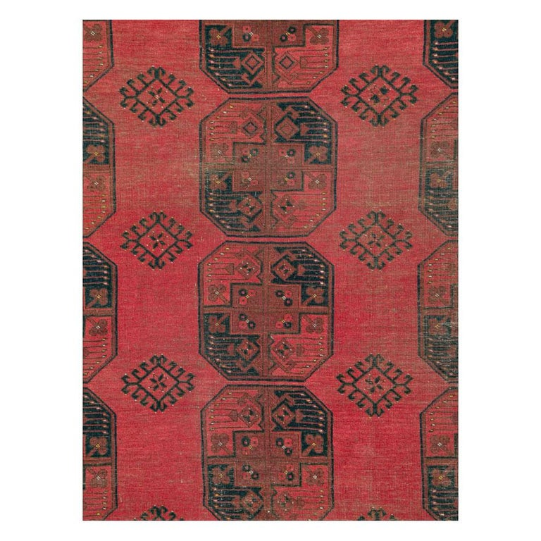 A vintage central Asian Tekke tribal room size rug, in shades of red and black, handmade during the mid-20th century with a distressed appeal, but otherwise in very strong and durable condition with no holes or tears.  Measures: 10' 0