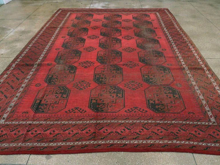 Distressed Mid-20th Century Tribal Tekke Room Size Carpet in Red and Black In Distressed Condition For Sale In New York, NY