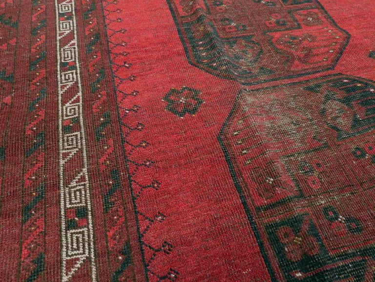 Wool Distressed Mid-20th Century Tribal Tekke Room Size Carpet in Red and Black For Sale