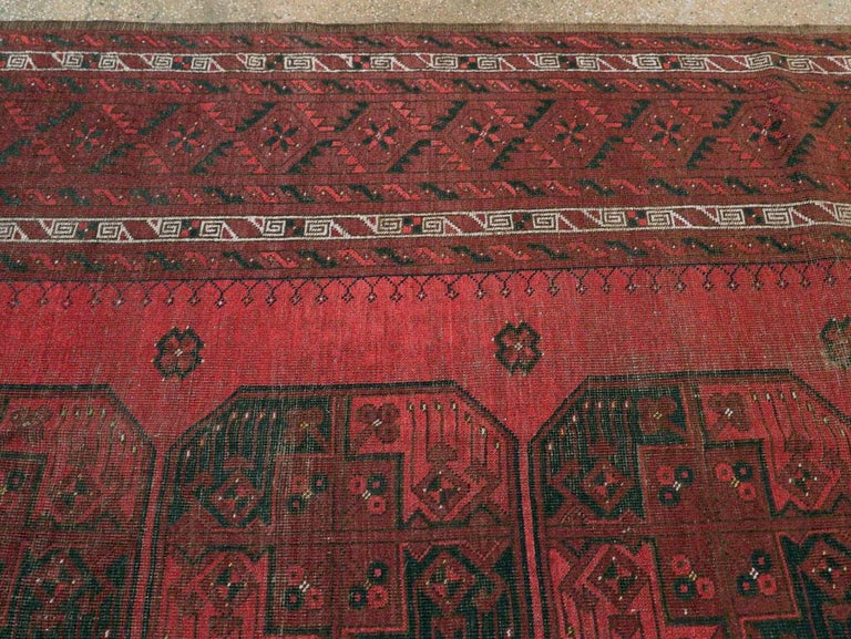Distressed Mid-20th Century Tribal Tekke Room Size Carpet in Red and Black For Sale 1