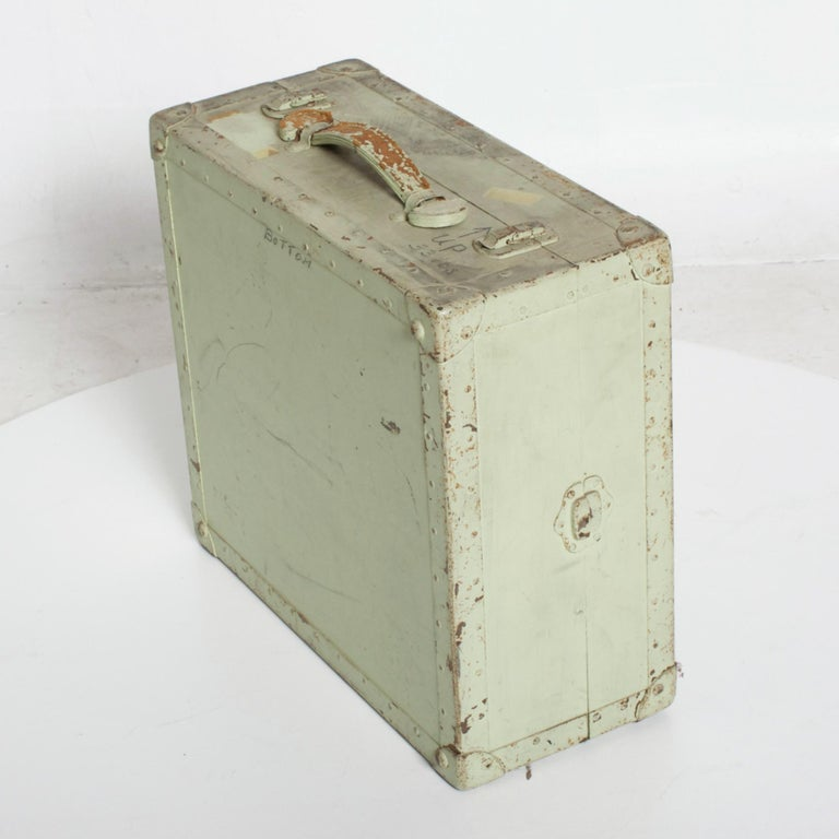 For your consideration: Vintage Military Carry case handled box in wood with leather handles, painted light green Appears as distressed Military Ammo box in light green Measures: 17.5 W x 7.75H x 15.75 D Original vintage distressed condition