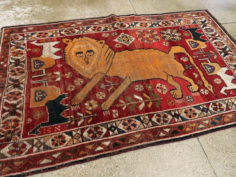 20th Century Distressed Persian Handmade Tribal Rug in Deep Red, Orange, and Ivory For Sale