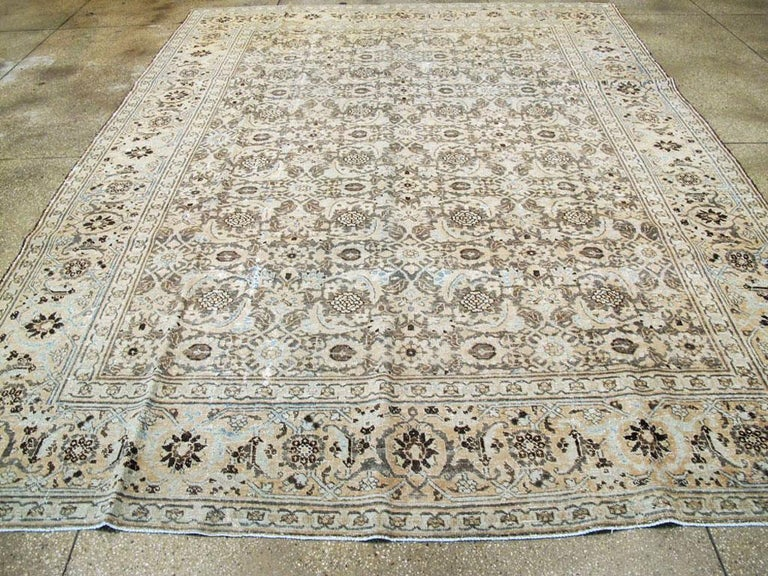Distressed Room Size Handmade Persian Carpet in Charcoal Brown, Nude, and Blue In Distressed Condition For Sale In New York, NY