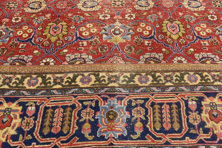 20th Century Distressed Vintage Persian Tabriz Area Rug with Relaxed Federal Style For Sale