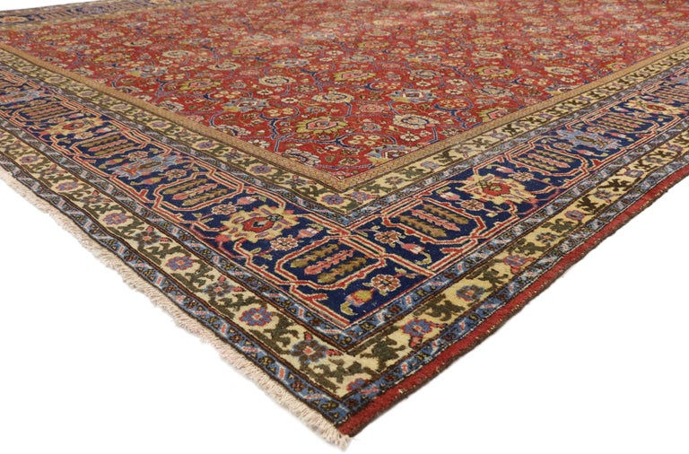 77216, Distressed Vintage Persian Tabriz Area Rug with Relaxed Federal Style. Regal hues, intricate details, and all-over symmetry create a neoclassical style in this hand knotted wool distressed vintage Persian Tabriz rug. Authentic, uneven wear