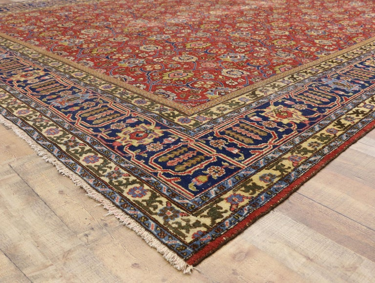 Wool Distressed Vintage Persian Tabriz Area Rug with Relaxed Federal Style For Sale