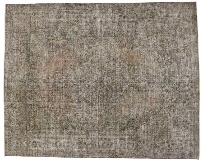 80322 Distressed Vintage Persian Tabriz Rug with Rustic Farmhouse Chippendale Style 11'01 x 14'01. Stylish and bold combined with defined and raw, this distressed vintage Persian Tabriz rug goes beyond the boundaries of design with historical