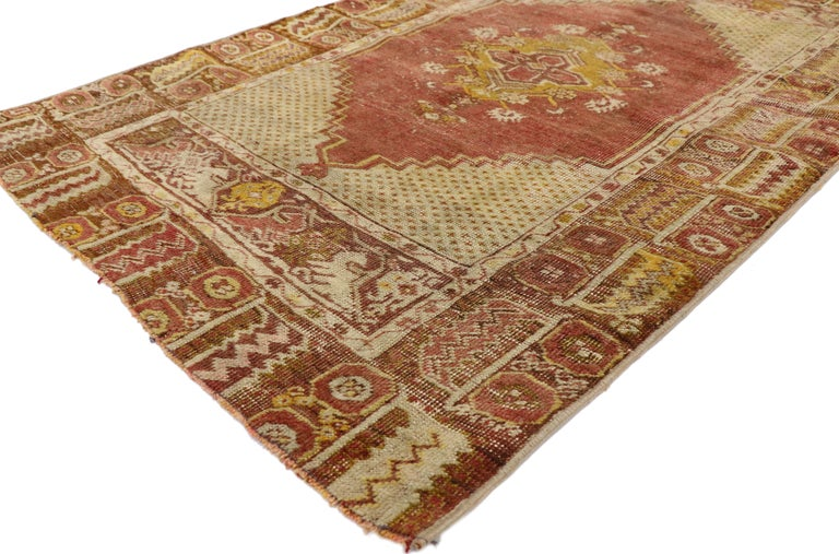 52775 distressed vintage Turkish Oushak rug. With warm spice-tones and lovingly timeworn appearance, this hand knotted wool distressed vintage Turkish Oushak rug embraces modern rustic style. It features a traditional medallion design composed of a