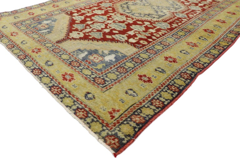 52778, distressed vintage Turkish Oushak rug with Rustic Modern Lodge style. Rusticity meets timeless Anatolian tradition in this hand knotted wool distressed vintage Turkish Oushak rug. It features a double stacked medallion outlined with spiked