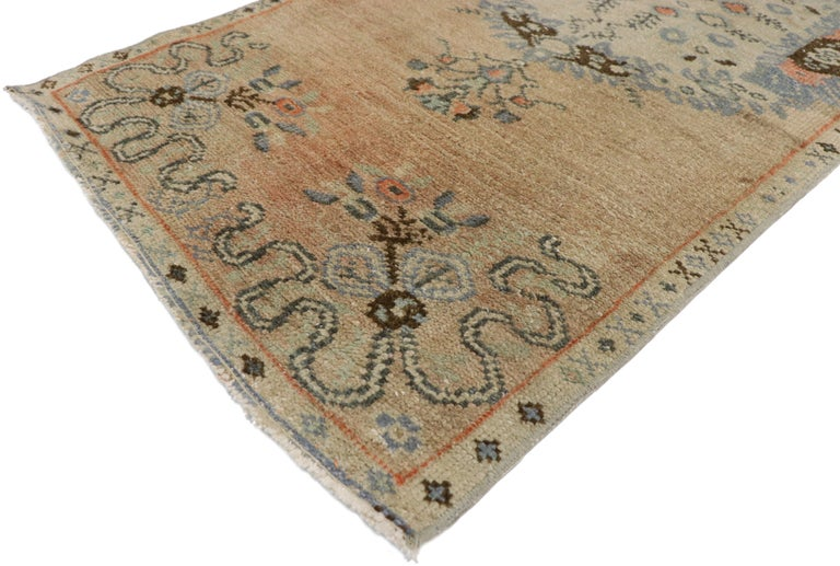52349, distressed vintage Turkish Oushak runner, narrow hallway runner with Swedish Farmhouse style. This distressed vintage Turkish Oushak runner features three ornate floral medallions with vase pendants across an abrashed peach and champagne