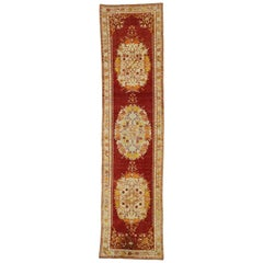 Distressed Vintage Turkish Oushak Runner with French Provincial and Rococo Style