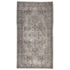 Distressed Vintage Turkish Overdyed Gray Rug with Feminine Industrial Style