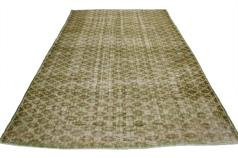 52003 Zeki Muren Distressed Vintage Turkish Sivas Rug with Industrial Art Deco Style. Warm and inviting combined with a bold pattern, this hand knotted wool distressed vintage Turkish Sivas rug embodies bold Art Deco style with a modern artisan