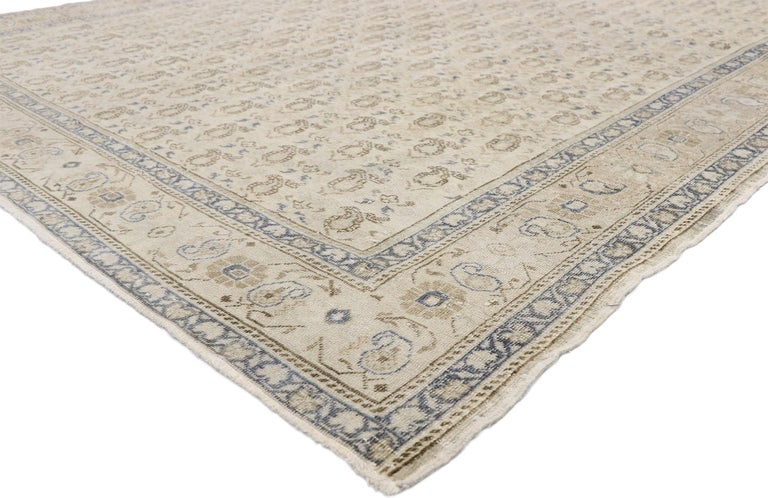 52653, distressed vintage Turkish Sivas rug with rustic British Colonial style. Warm and inviting combined with neutral hues and cozy simplicity, this hand knotted wool distressed vintage Turkish Sivas rug charms with ease and beautifully embodies