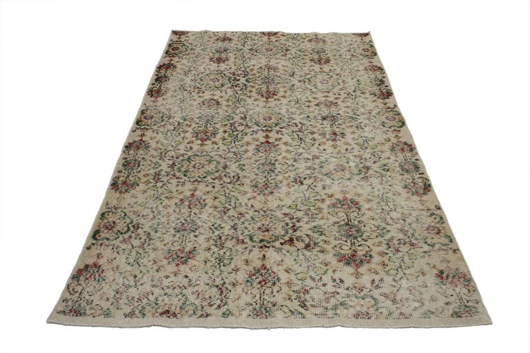 52011, distressed vintage Turkish Sivas rug with shabby chic farmhouse style. This hand-knotted wool distressed vintage Turkish Sivas rug features a shabby chic farmhouse style. The all-over floral pattern is composed of lush flowers and cruciform
