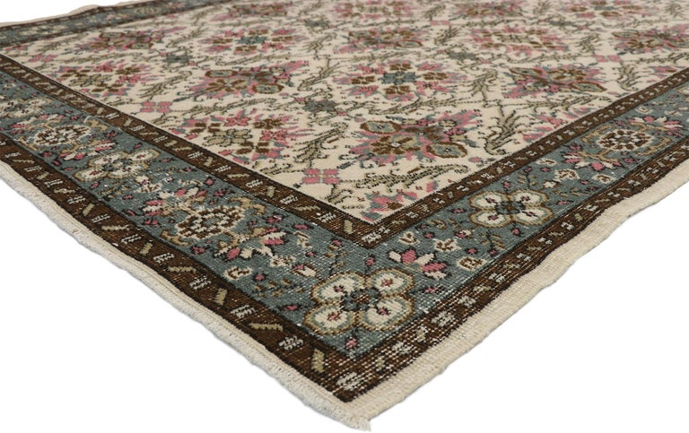 52573 Zeki Muren Distressed Vintage Turkish Sivas rug with Swedish cottage Gustavian style. Whimsy and rusticity collide in this hand knotted wool distressed vintage Turkish Sivas rug. It features an all-over floral trellis composed of alternating