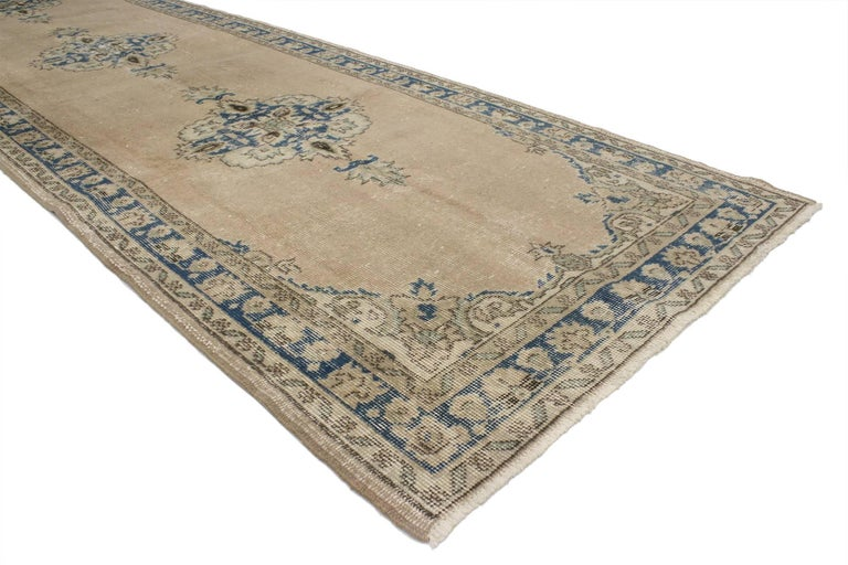 52118 Distressed Vintage Turkish Sivas Runner with Gustavian Farmhouse Style. This hand-knotted wool distressed vintage Turkish Sivas runner features three stylized medallions patterned and anchored with blooming palmettes. It is framed with