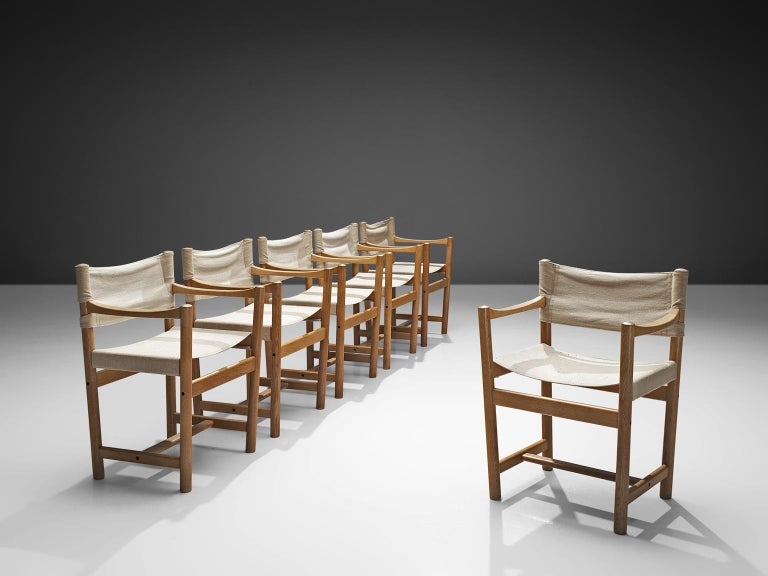 Ditte and Adrian Heath for FDB Møbler, armchairs, canvas and oak, Denmark, 1960.  This Danish set of chairs is made by the duo Ditte and Adrian Heath. The chairs have a wonderful design, featuring a tapered frame made of oak. The canvas gives the