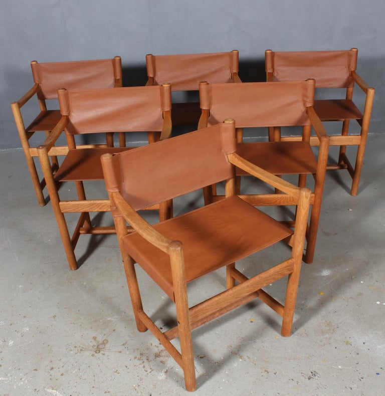 Ditte Heath armchairs in oak.   New upholstered with tan aniline leather.  Model J102, made by FDB.
