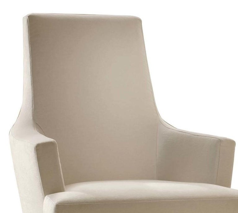 Designed to add a bold accent to a living or dining room, this stunning armchair offers balanced proportions and superior comfort. Boasting a solid frame draped in soft fabric upholstery in a versatile ivory color (col. 1020/100/4 cat. Extra), the