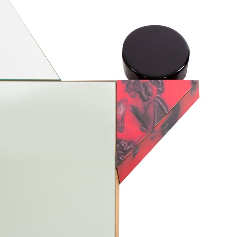 Diva Mirror with plastic laminate, was originally designed in 1984 by Ettore Sottsass.  Ettore Sottsass was born in Innsbruck in 1917. In 1939 he graduated in architecture at the Politecnico di Torino One of the most influential and important