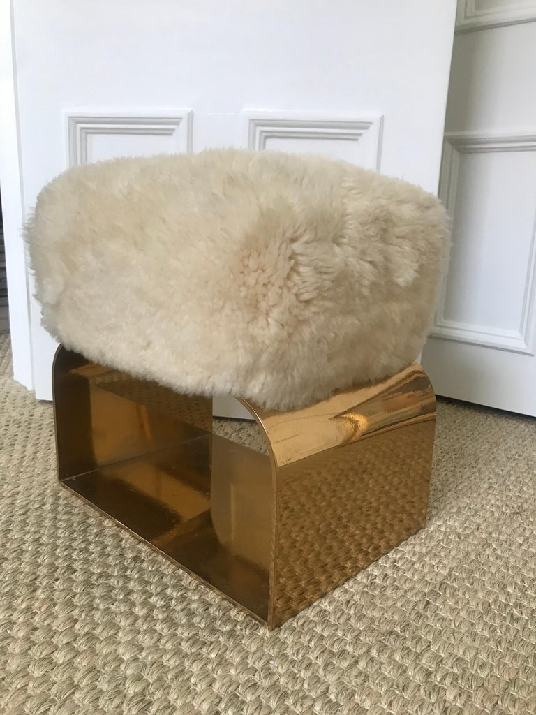 Polished brass base with a natural Patagonian sheepskin top.
