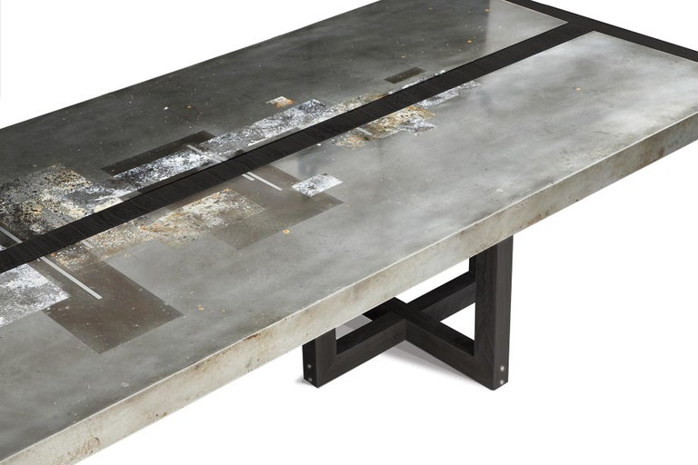 A work of art for your dining room! This Studio Roeper original features an acid-etched zinc top in our signature patina style. The industrial character of the metal is complemented by the neutral black palette of the ebonized walnut wood finish.
