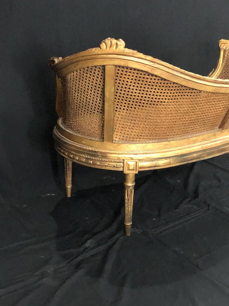 Divine Curved Back French 19th Century Louis XV Style Gilt Caned Loveseat Settee For Sale 11