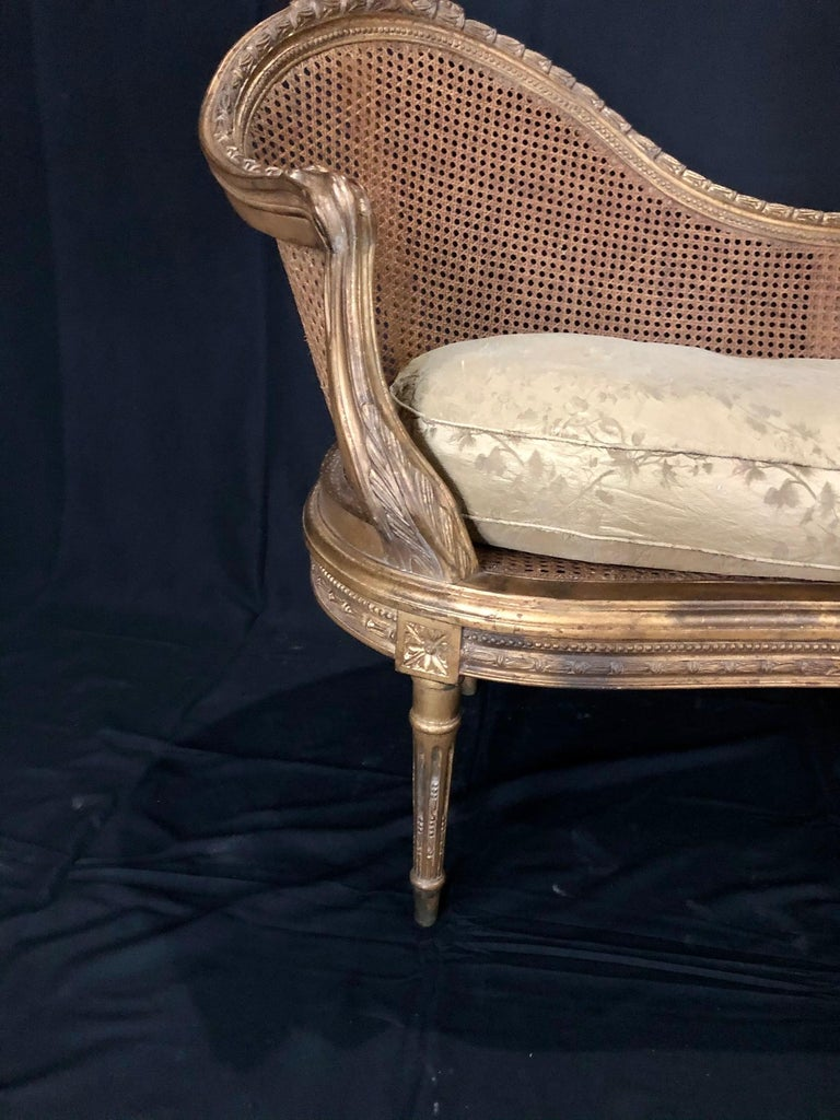"""Beautiful curved back French Louis XV style gold gilt caned loveseat settee with immaculate caning and original separate down cushion. #5074   Measure: H seat 15-23"""" (without/with cushion)."""