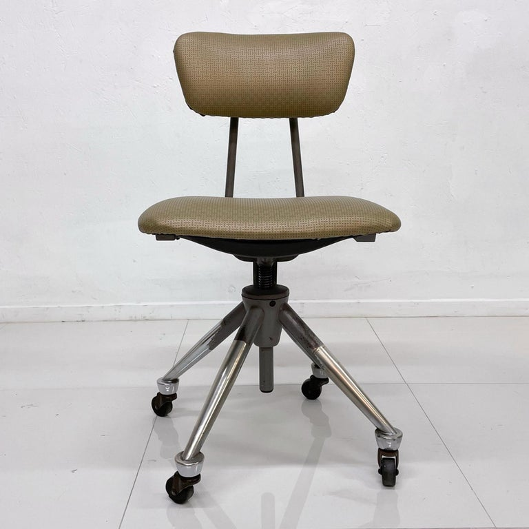 For your consideration, a Do More Office Chair Mid-Century Modern industrial era.  Domore Chair Company, Inc. (also referred to as Do-More or Do/More) was founded in 1922 by William S. Ferris in Elkhart, Indiana. Its industry was furniture and its