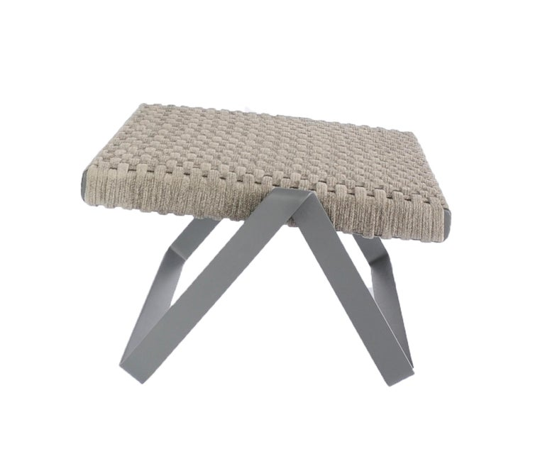TheDobra outdoor footstool is made to match the lounge chair part of the Dobra furniture line which is designed with the concept of a continuous steel bar folded to create legs and frames for the different components.