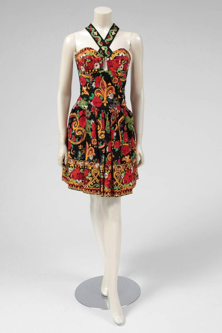 Amazing documented (see picture 7) print cotton dress by Christian Lacroix. With an exuberant and colorful vibrant print, the dress has also a black tulle petticoat which provides more volume to the skirt. The back of the dress has oversized corset
