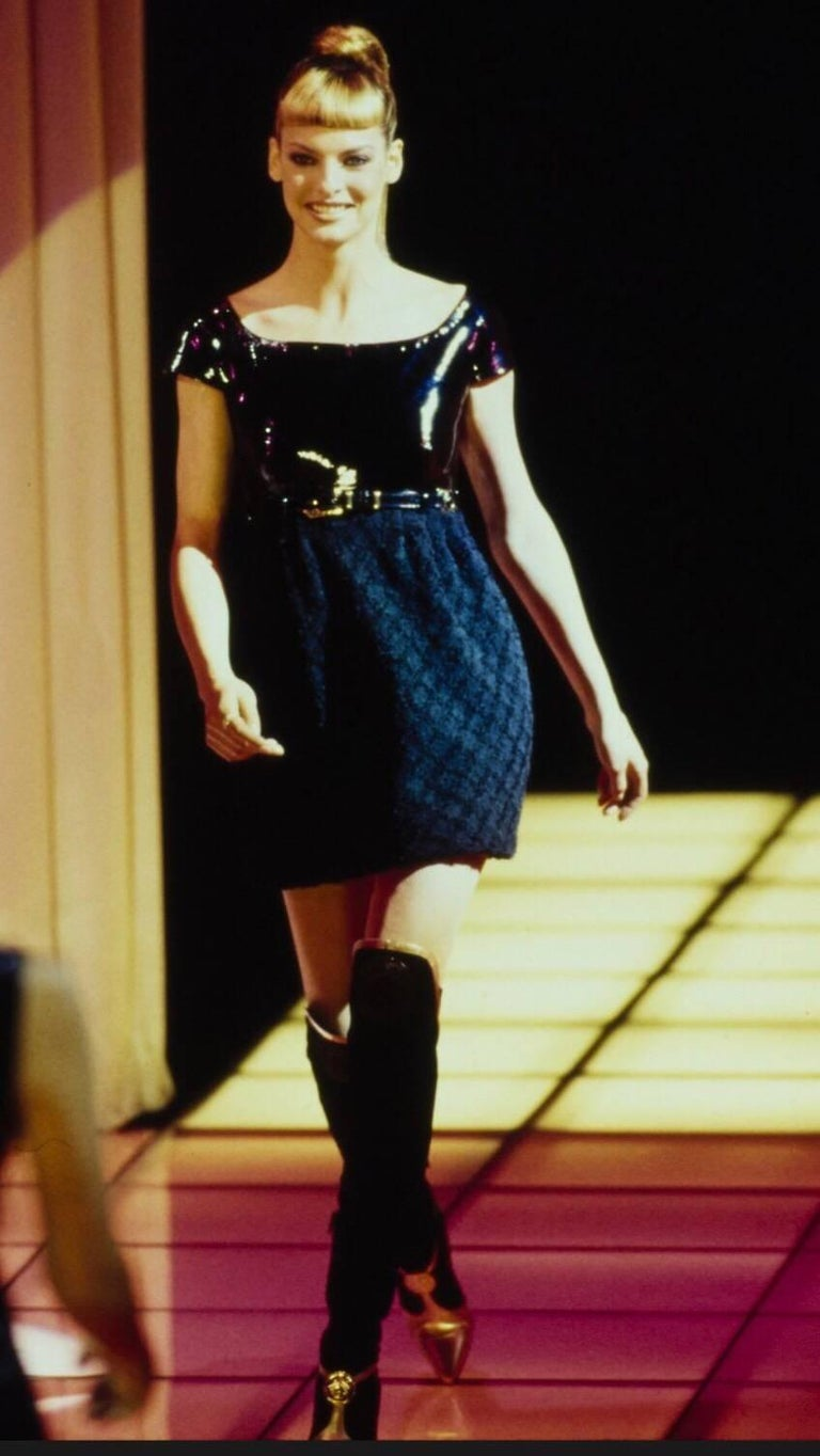Documented rare GIANNI VERSACE COUTURE Fall/Winter 1994 runway dress! Linda Evangelista strutted down the runway in this beauty (see photo). Fitted PVC fitted bodice looks like patent leather, and has cap sleeves. Wool boucle skirt, and detachable