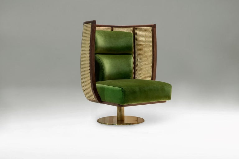 The high back caned armchair revolves around its own universe with a refined, elegant and distinctive frame. It makes you feel powerful and ruler of your space.  This seat is available in stock. For customization options please inquire for