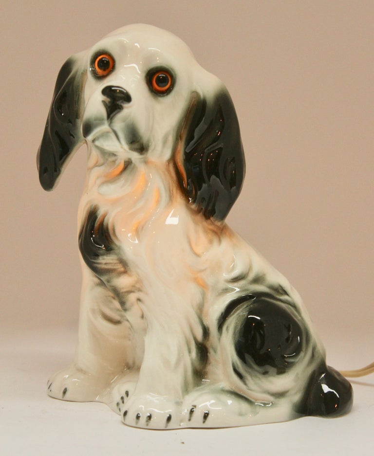 Rare and gorgeous dog perfume lamp attributed to Carl Scheidig Grafenthal, Germany. Excellent condition, lamp is in working order. Size: Height 17 cm, 6.7 in, width 11 cm, 4.33 in. Germany, 1930s, excellent condition Porcelain figurine / air