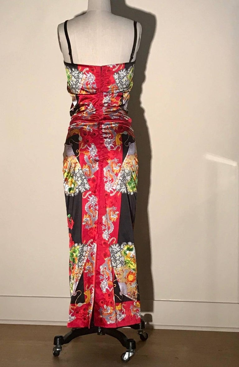 Dolce & Gabbana 1999  black and red dress as seen in the collection at the Museum at FIT. Slinky dress features lavender dragons, stylized fans featuring folk scenes, and red roses.  Closes with a series of hook-and-eye closures at center back.