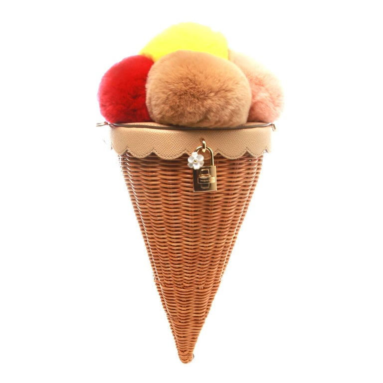 Multicolour ice cream cone bag from Dolce & Gabbana featuring a gold-tone twist lock fastening, a woven design and an adjustable shoulder strap.  Strap 55cm  Outer Composition: Rabbit Fur 40% Outer Composition: Calf Leather 10% Outer Composition: