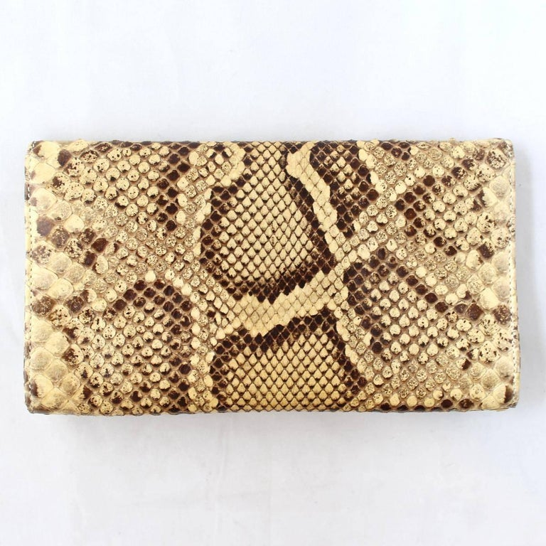 Dolce & Gabbana super chic and trendy pochette Real reptile Amber rock color Metal DG Metal chain Double authomatic button closure Internal poket  Cm 21 x 11 (8.2 x 4.3 inches) Worldwide express shipping included in the price !