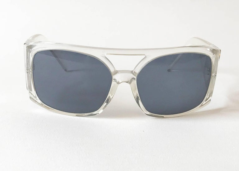 Oversize glamourous Dolce & Gabbana sunglasses. Transparent frame and chromed initial of the logo on each side.  The lenses are smoked blue. Model DG4018. Original case included.