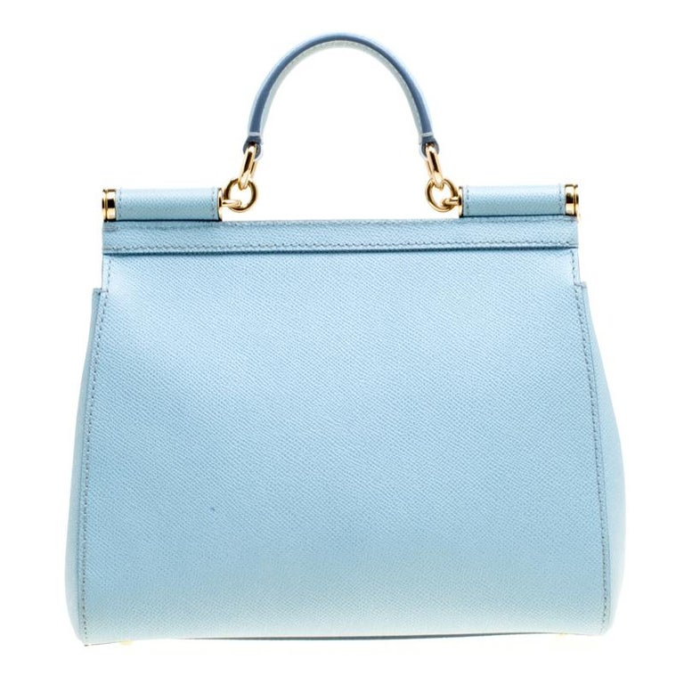 The Miss Sicily range of bags is one of the most celebrated creations from Dolce and Gabbana. This baby blue beauty beautifully embodies the spirit of extravagance and feminity that the Italian luxury brand carries. Crafted from leather, the bag has