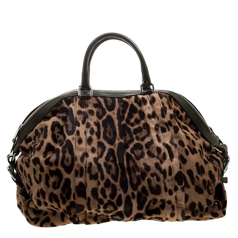 This stunning satchel is by Dolce&Gabbana. Crafted from calf hair, the bag features leopard-prints all over, two handles and a spacious fabric interior. Swing it along while you travel to lend your outfit the appropriate measure of class and