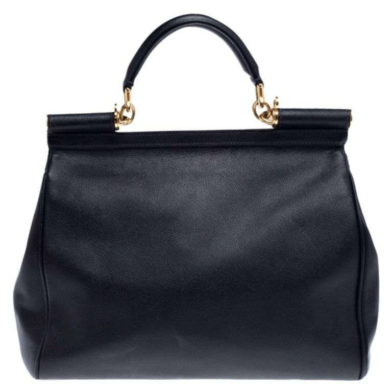 This gorgeous black Miss Sicily top handle bag from Dolce & Gabbana is coveted by women around the world. It has a well-structured design and a flap that opens to a compartment with fabric lining and enough space to fit your essentials. The bag