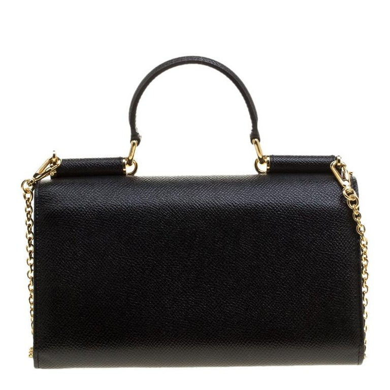 This Disco clutch is a celebrated creation by Dolce and Gabbana. It is not just elegant but utterly fashionable which is why it is so loved by fashion-forward women. This bag comes in a black hue with a structured design that features a top handle