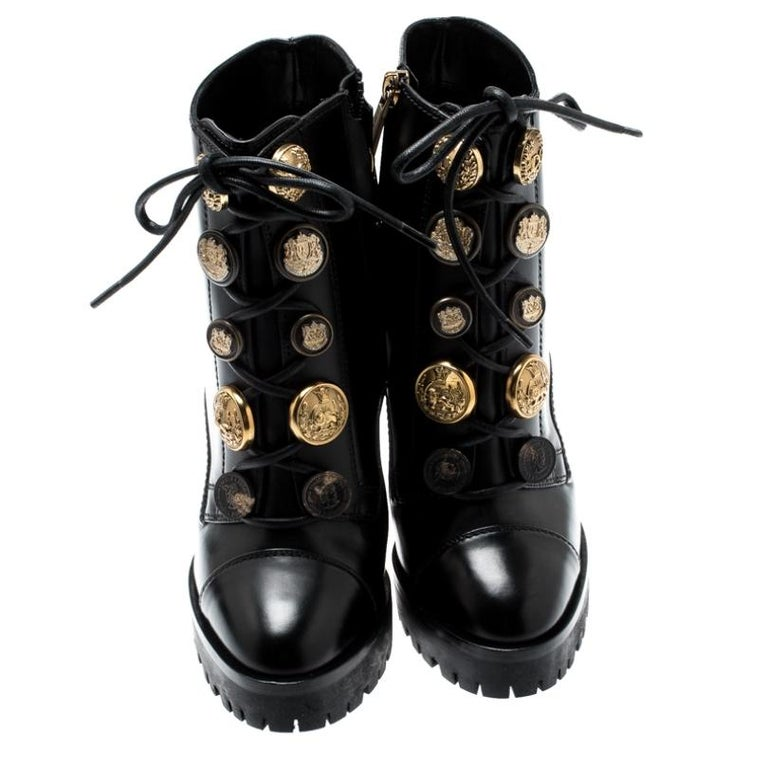 Go all out with these stylish Dolce & Gabbana boots that exude a biker chic vibe. The block heels and the button embellishments add on to the appeal of these boots. They also feature a laced front and platforms.  Includes: Original Dustbag, Original