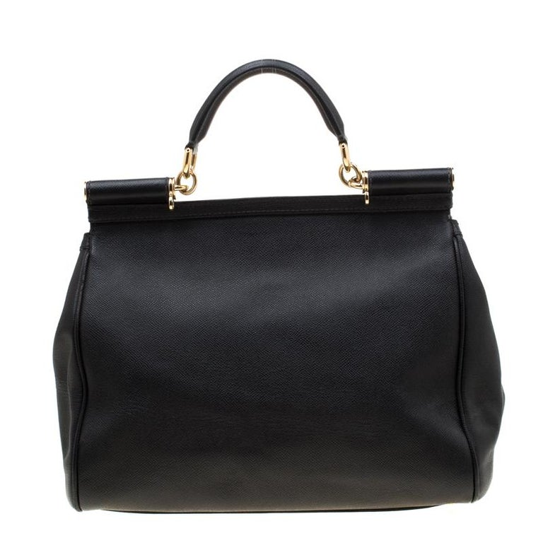 This gorgeous black Miss Sicily tote from Dolce & Gabbana is a leather bag coveted by women around the world. It has a well-structured design and a flap that opens to a compartment with fabric lining and enough space to fit your essentials. It comes