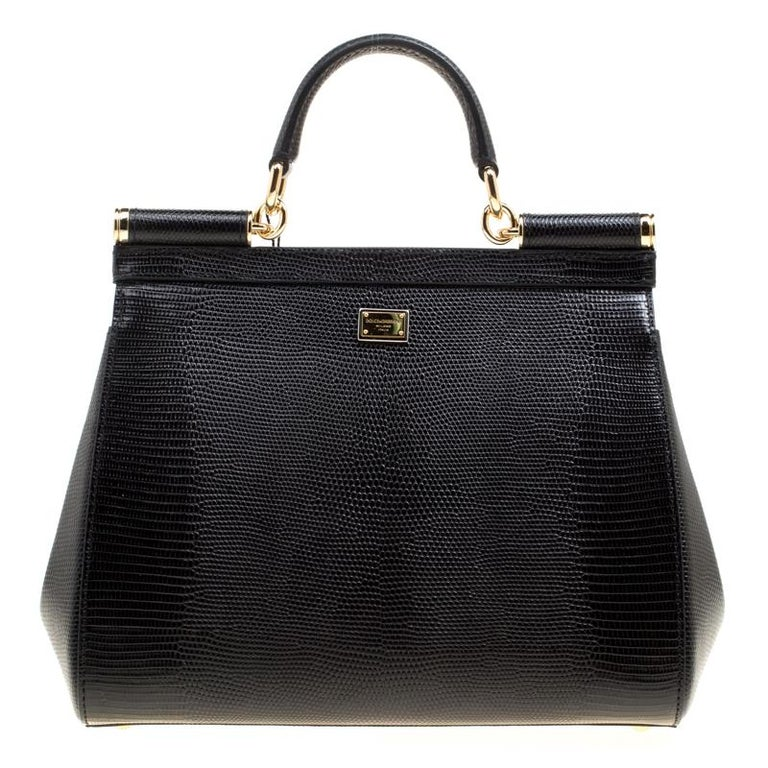 The Sicily range of bags is one of the most celebrated creations from Dolce and Gabbana. This black beauty beautifully embodies the spirit of extravagance and feminity that the Italian luxury brand carries. Crafted from leather, the bag has a