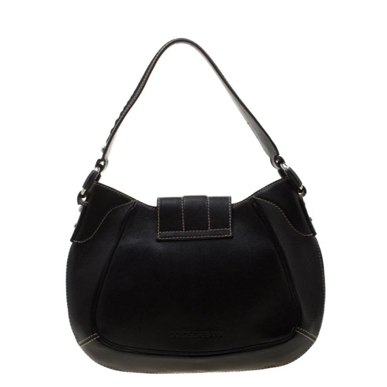 This sleek leather bag, with a fabric interior and silver-tone hardware, is luxurious enough to elevate your everyday style. The black bag is by Dolce & Gabbana and it is designed to be durable and handy.  Includes: The Luxury Closet Packaging