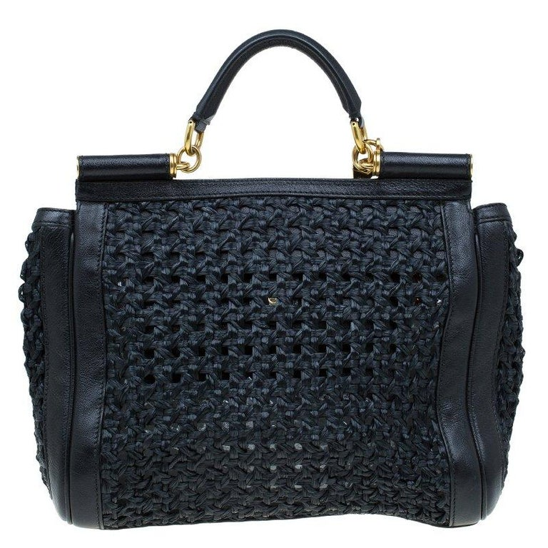 This classic masterpiece from Dolce and Gabbana is perfect to flaunt around at your parties. Crafted from raffia, this Miss Sicily bag is accented with gold-tone detailing. It features the signature structured Sicily top with single handle, and a