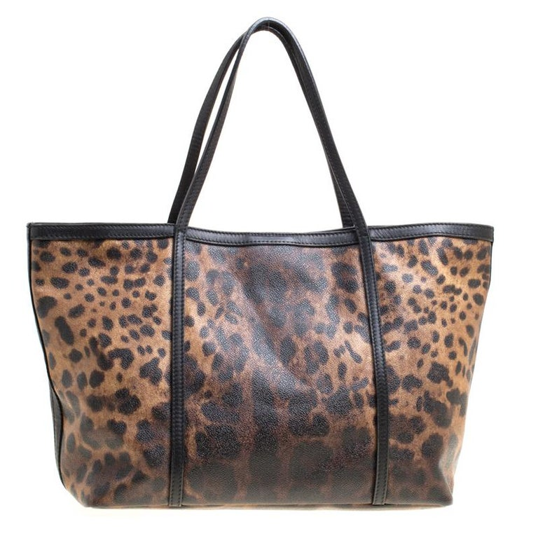 You know what would be the perfect tote to swing for your daily errands or sprees? This one here from Dolce&Gabbana. It is perfect! Crafted from leopard-printed canvas, the bag has a lovely shape, two leather handles and a spacious fabric
